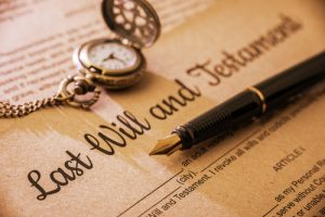 last will and testament, will & trust, estate planning, legal document with calligraphy pen & pocket watch on top